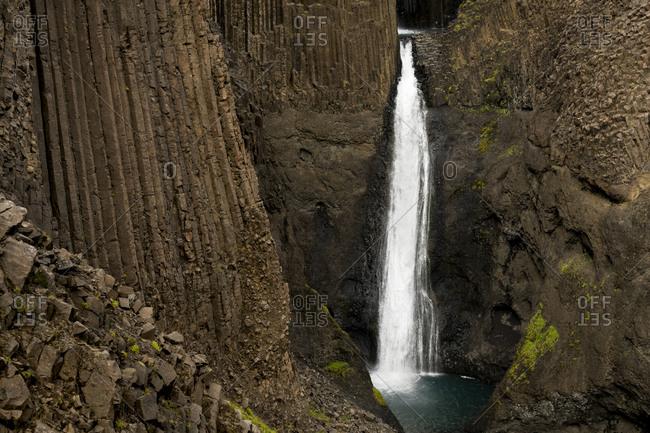 High angle view of litlanesfoss waterfall and basalt columns, eastern region, iceland