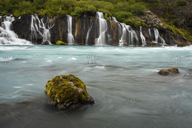 Idyllic view of hraunfossar waterfall on river hvita, near barnafoss, iceland