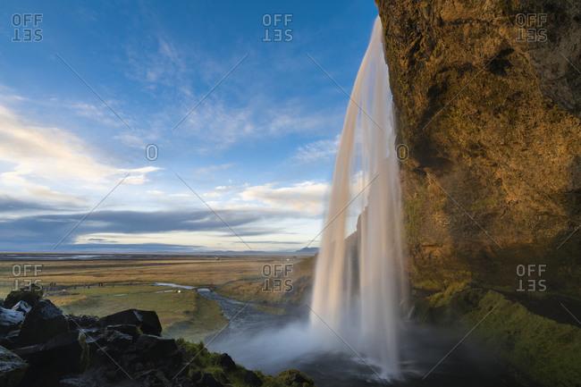 Idyllic shot of seljalandsfoss waterfall against sky, south iceland