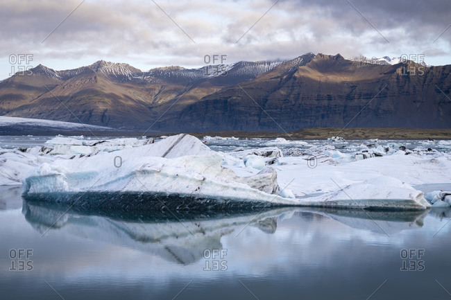 View of icebergs at jokulsarlon glacier lagoon against mountains, iceland