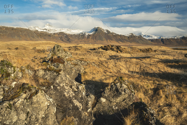 Scenic view of snowcapped mountains against cloudy sky, budir, snaefellsnes peninsula, iceland
