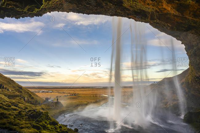 Idyllic shot of seljalandsfoss waterfall with tourists, south iceland