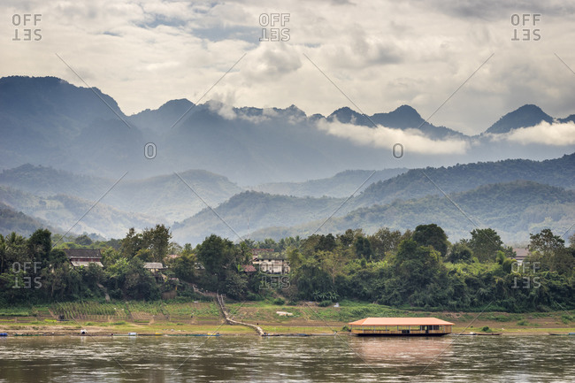 Scenic view of mekong river against mountain range, luang prabang, laos