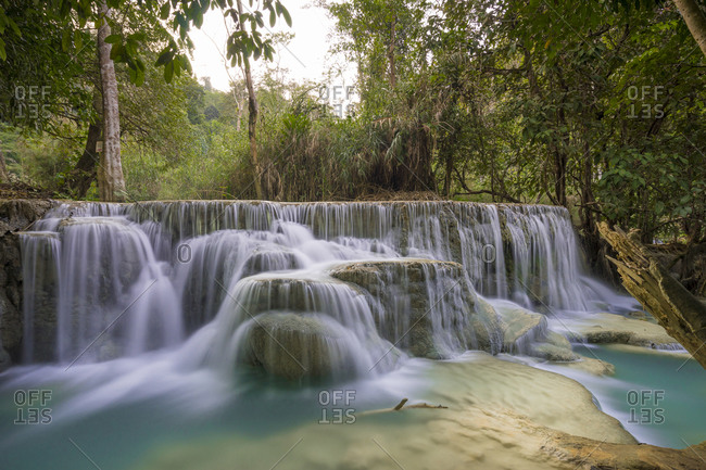 Idyllic shot of waterfall near kuang si waterfalls, luang prabang, laos