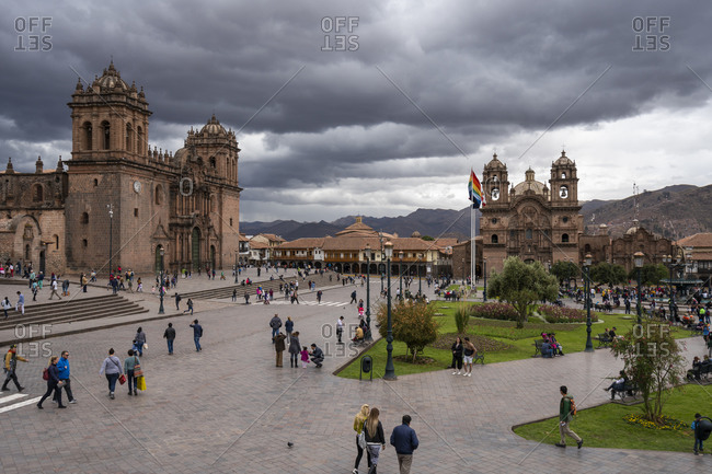 Cusco, cusco, peru - october 7, 2018: tourists at cusco cathedral and church of the society of jesus at plaza de armas, cusco, peru