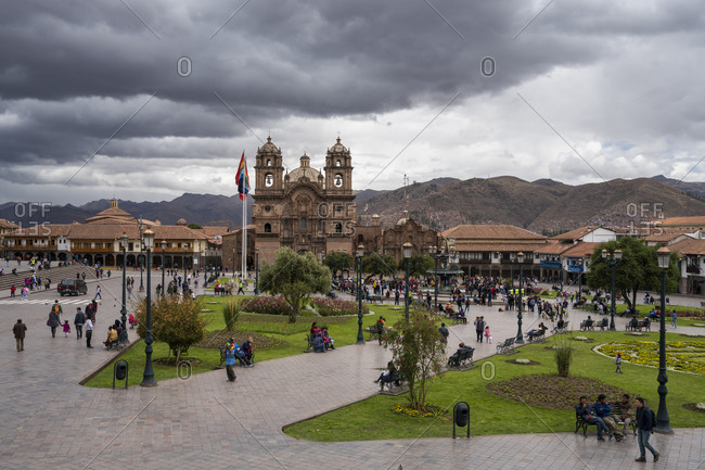 Cusco, cusco, peru - october 7, 2018: tourists at church of the society of jesus at plaza de armas, cusco, peru