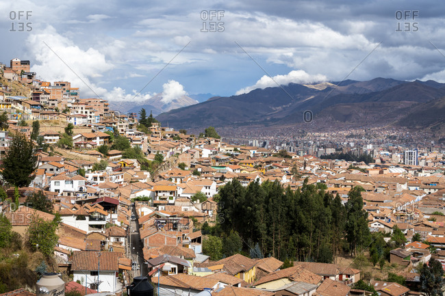 Elevated view of cusco city with mountains in background, peru
