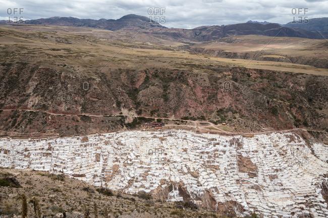 Aerial view of salt mines at salineras de maras, sacred valley, peru