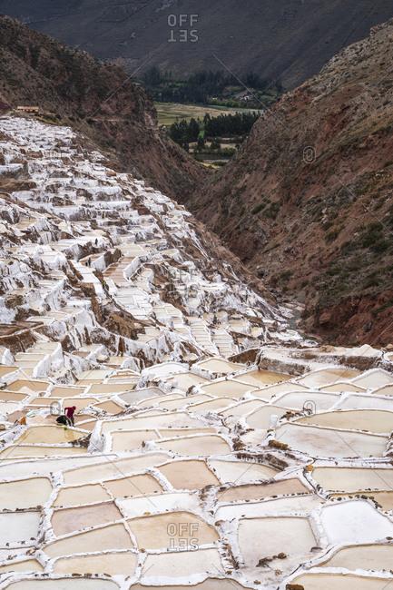 Elevated view of salt mines at salineras de maras, sacred valley, peru