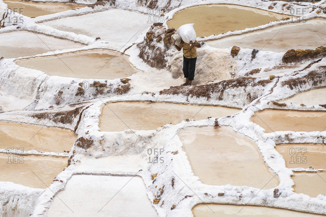 Man working at salineras de maras, sacred valley, peru