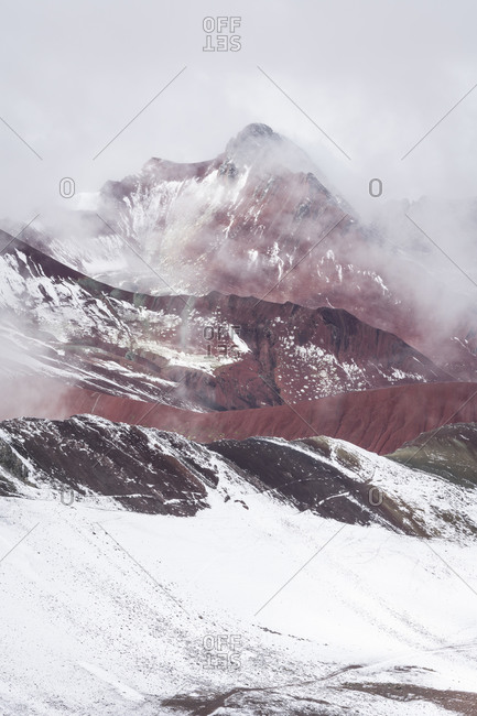 Snow covered red valley seen from rainbow mountain trail, pitumarca, peru