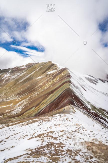 Idyllic shot of rainbow mountain during winter, pitumarca, peru