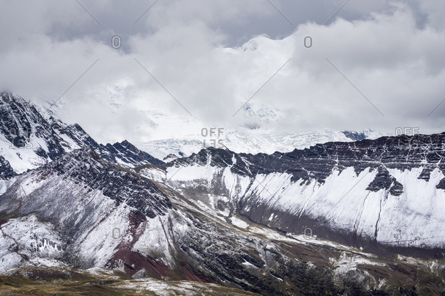 Scenic view of valley in the andes near rainbow mountain trail during winter, pitumarca, peru
