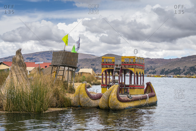 Boat made of reed moored at uros islands, lake titicaca, peru