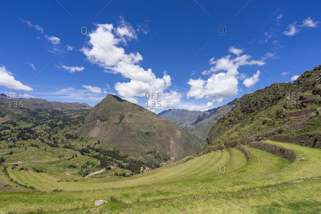 Terraces of pisac against sky, sacred valley, cusco, peru