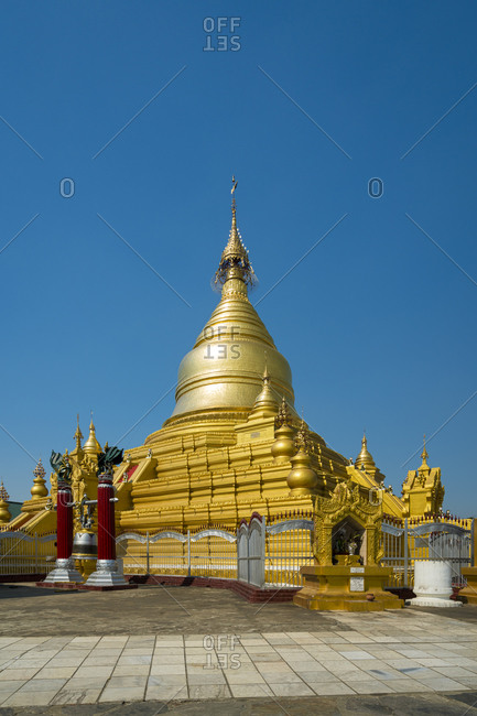 Exterior of golden kuthodaw pagoda against clear blue sky, mandalay, myanmar
