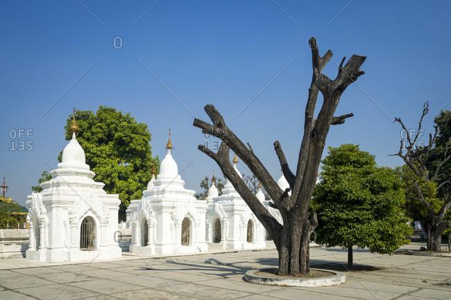 Kuthodaw pagoda against sky on sunny day, mandalay, mandalay region, myanmar