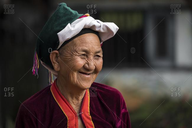 Hsipaw, shan, myanmar (burma) - january 15, 2018: portrait of smiling senior woman of palong tribe wearing headwear, near hsipaw, myanmar