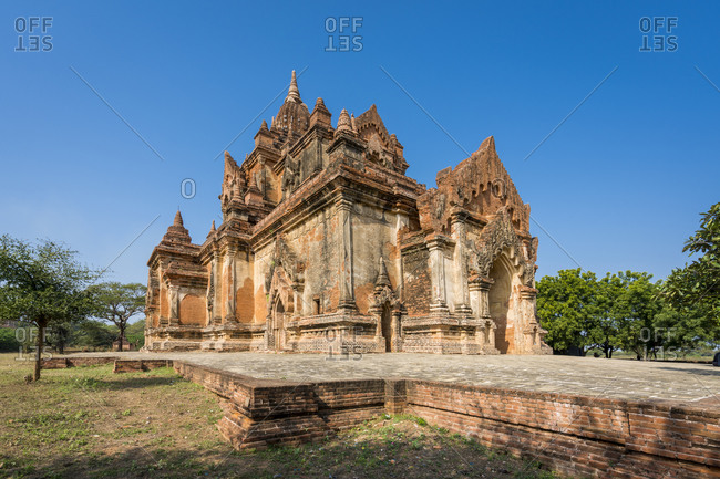 Exterior of historic temple against clear blue sky, unesco, bagan, myanmar