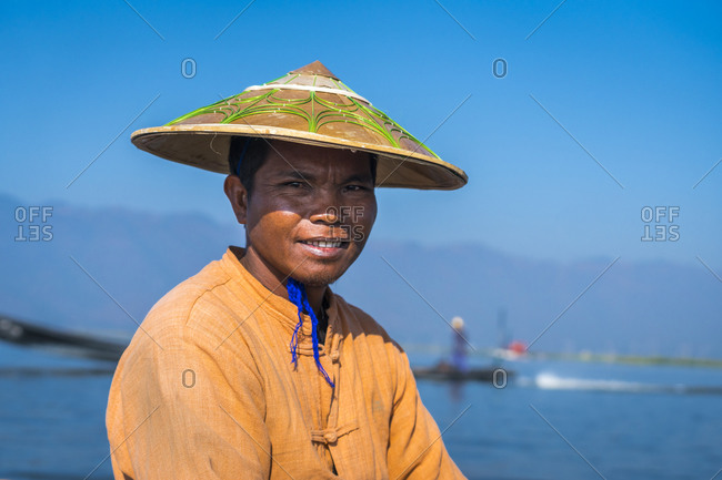 Nyaungshwe, shan, myanmar (burma) - january 20, 2018: close-up of intha fisherman against clear blue sky, lake inle, nyaungshwe, myanmar