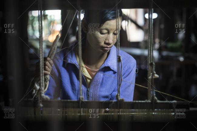 Nyaungshwe, shan, myanmar (burma) - january 20, 2018: woman working in weaving manufacture