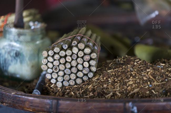 Detail shot of bundle of burmese cigars and tobacco in workshop, lake inle, myanmar