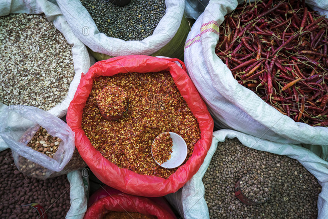 Overhead view of seeds and red chili peppers for sale at market, nyaungshwe, lake inle, myanmar