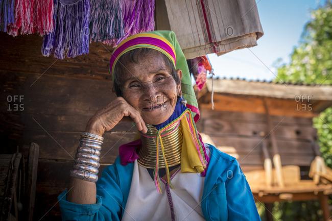 Loikaw, kayah state, myanmar (burma) - january 23, 2018: portrait of smiling senior burmese woman from kayan tribe, mya