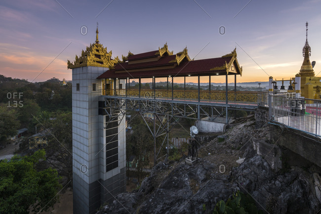 Loikaw, kayah state, myanmar (burma) - january 23, 2018: elevator at taung kwe pagoda against sky during sunset, loikaw, myanmar