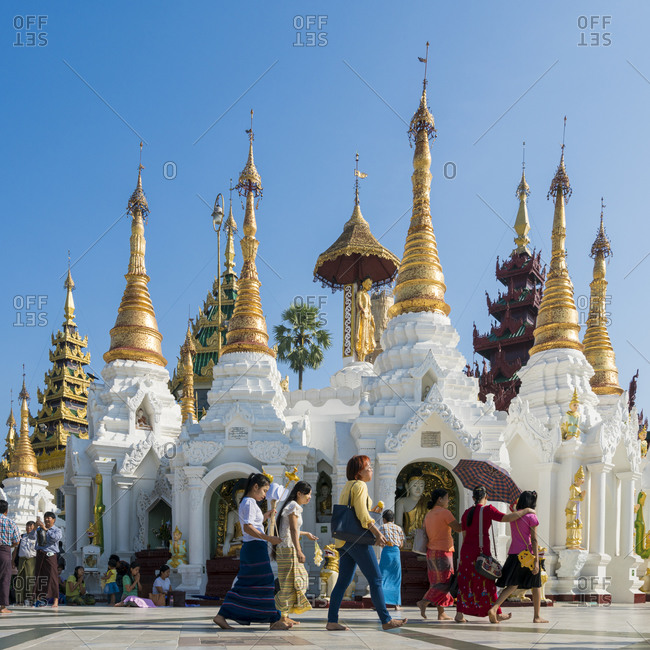 Yangon, yangon region, myanmar (burma) - january 28, 2018: white buddhist temple at shwedagon pagoda complex, yangon, myanmar