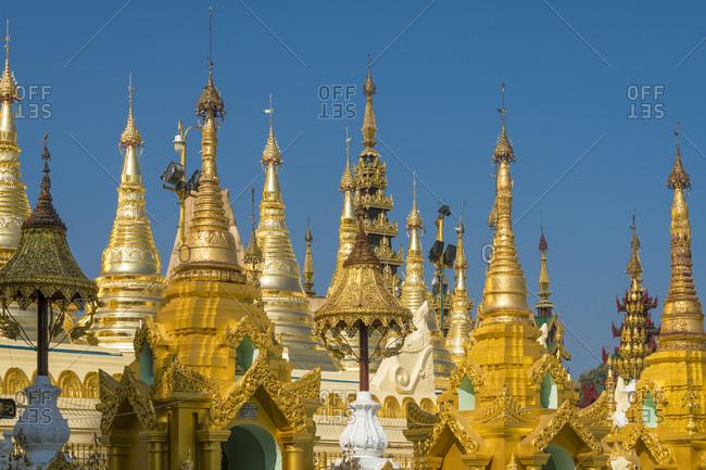 Detail shot of gilded pagodas at shwedagon pagoda complex, yangon, myanmar