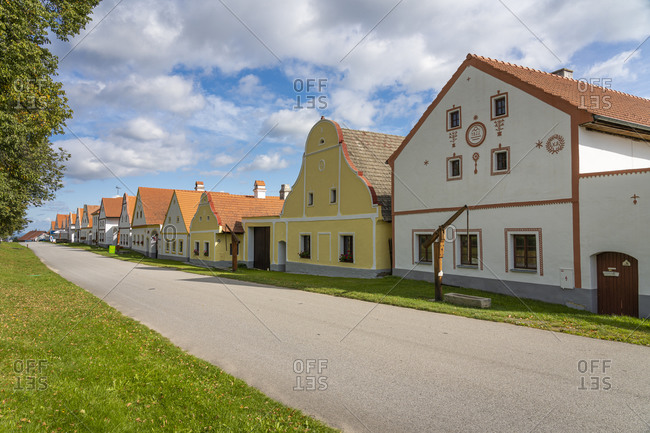 Ceske budejovice, south bohemian region, czechia - september 19, 2019: historical houses at holasovice historic village reservation. they represent rural baroque style, unesco, holasovice, south bohemian region, czech republic