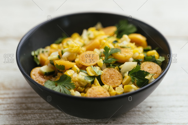 Home made corn and physalis salad in a bowl