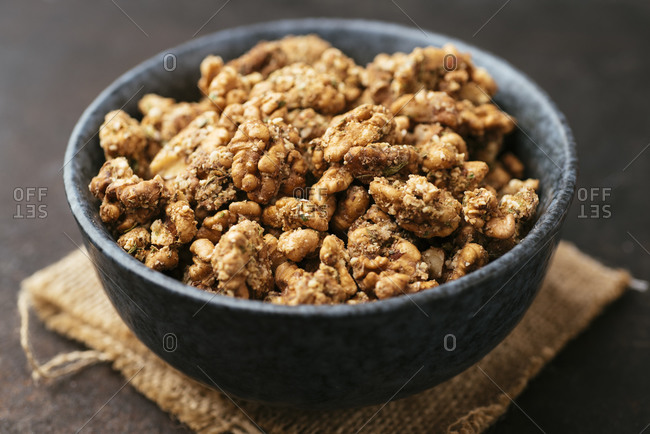 Toasted walnuts with vegan parmesan, herbs and spices as healthy snack