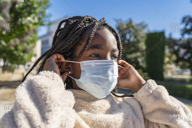 Beautiful african girl with a mask to avoid covid19