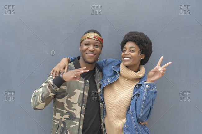 African couple smiling to receive a photo