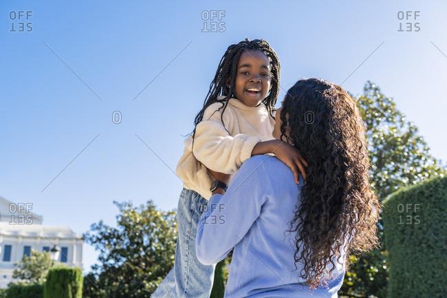 Little girl hugging her mother