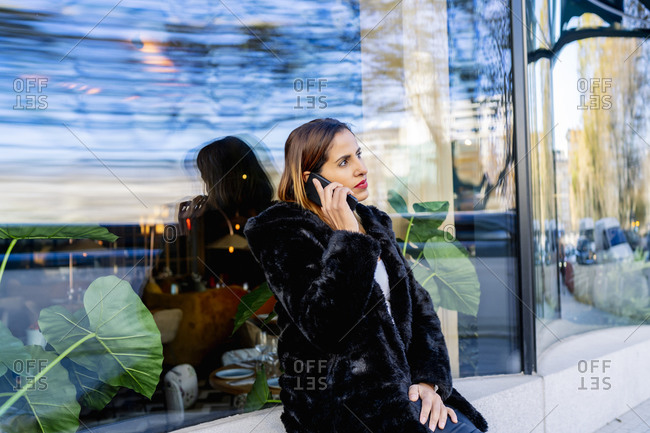 Executive woman in the city talking on her smartphone