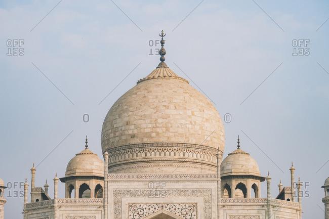 Taj mahal dome from the distance against hazy sky, agra.