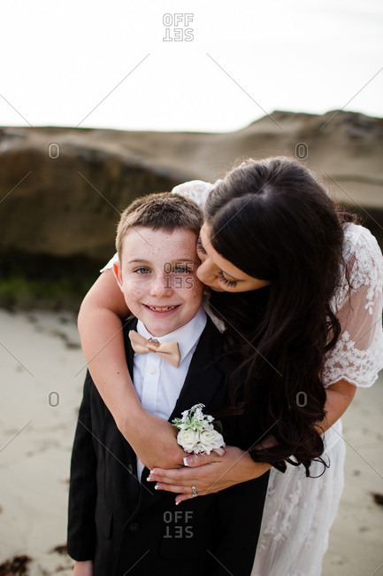 Mother embracing son on windansea beach in san diego
