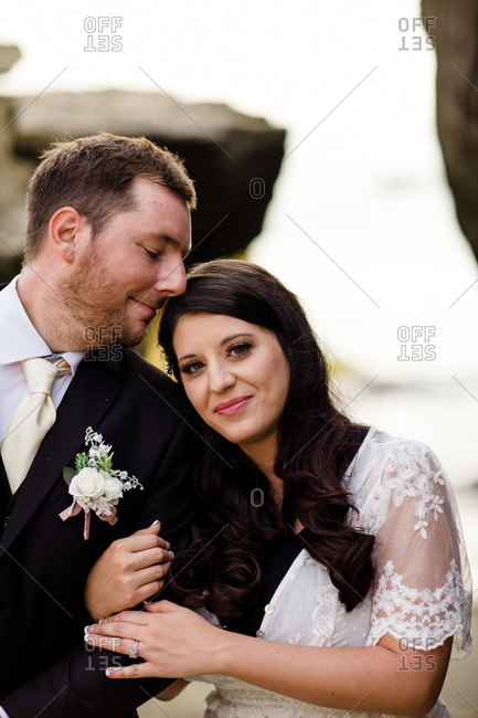 Close up of newlyweds on beach in san diego
