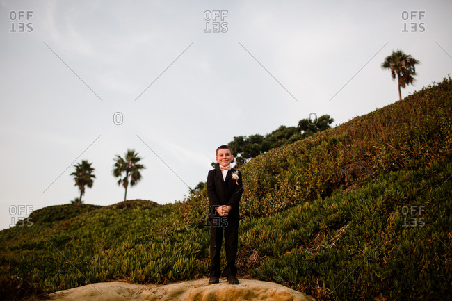 Nine year old boy in tux at beach in san diego