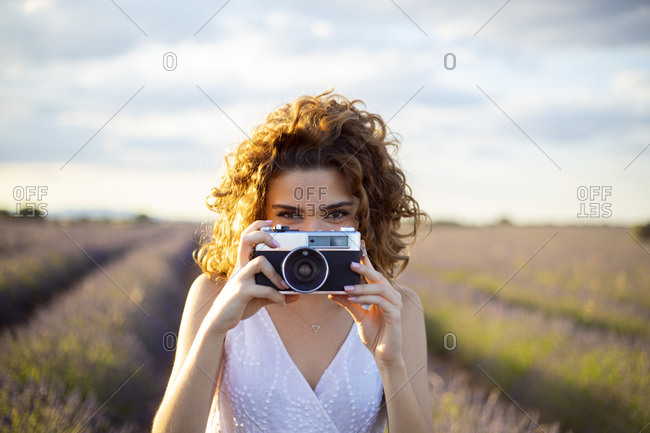 Woman with a photo camera in a lavender field