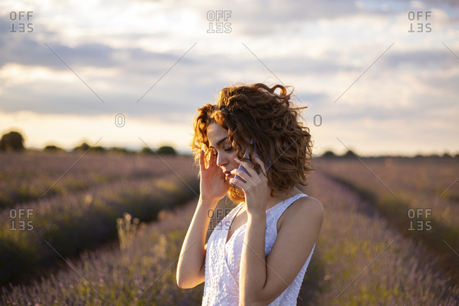 Woman with mobile phone in a lavender field