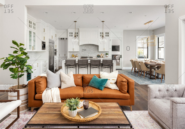 Living room and kitchen in new farmhouse. style luxury home