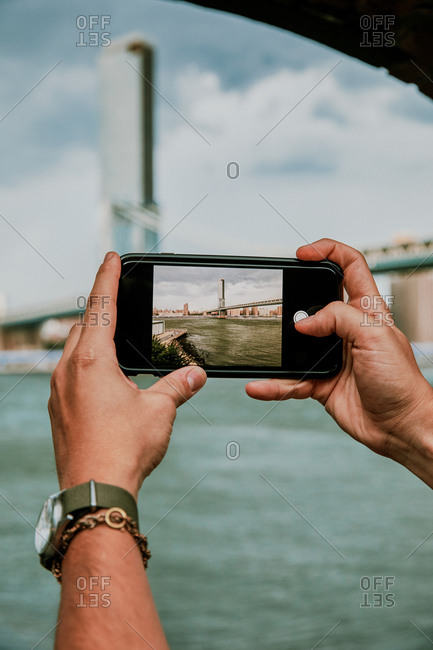Phone screen taking picture of city skyline.
