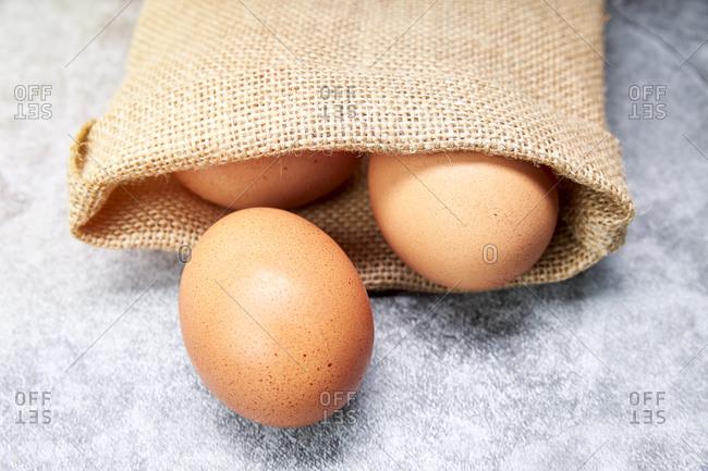 Chicken eggs in a raffia bag. healthy food concept