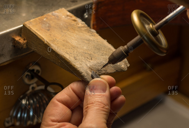 Hands of an artisan jeweler working jewelry. jewelry goldsmith