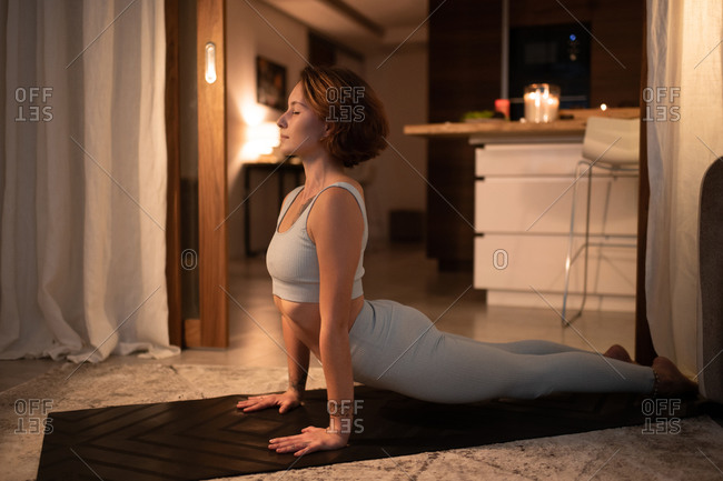 Slim woman stretching body during yoga lesson