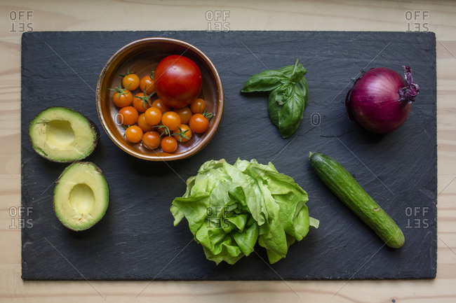 Above-view of colorful fresh vegetables arrayed on a cutting board